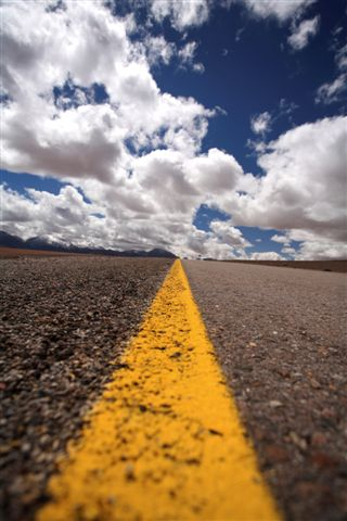 Cloudy sky over a road to symbolize a journey as in the journey of a family caregiver