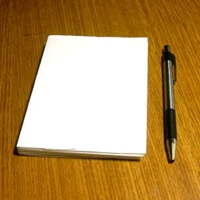 a picture of a notepad and pen on the tips and forms page for caregivers