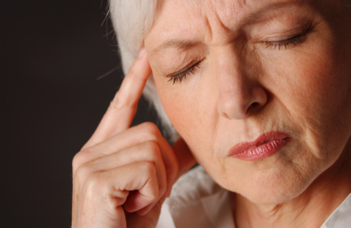 elderly womanwith a migraine